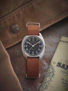 Powered by the awesome H-50 handwinding movement with 80 hours of power reserve, the Khaki Pilot Pioneer is a reinterpretation of a vintage military watch produced for the British Royal Air Force in 1973. Featuring a distinctive dial pattern and robust NATO strap, this is a military watch with real character.