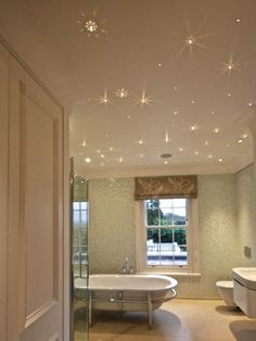 There is a sense of serenity with the starry night lighting scheme. During the day light comes through the sash windows reflecting off the enamel bath and glass shower enclosure. At night the room becomes a place of calmness with a starry sky effect on the ceiling with the Orian 35 Fibre Optic Swarovski Crystals.