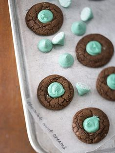 To make these cookies look extra fancy, use a table knife, toothpick, or wooden skewer to swirl the mint kisses into the cookies after they have had a couple minutes to melt in the oven.