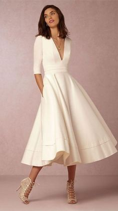 Brides looking for unique wedding dresses must check out BHLDN. It's full of styles and cuts that are beautifully different (like this calf-length dress with a deep v-neck and sleeves that go to the elbows).