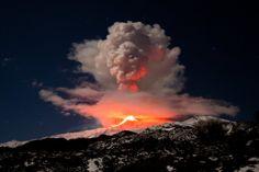 Eruption of Mt. Etna in Sicily against a starry sky