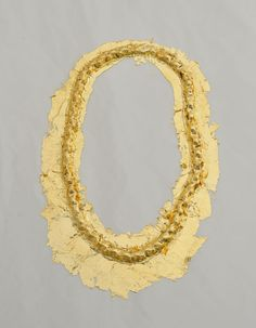 """Avishag Goldman, """"Can a necklace be assimilated as a memory of the body?"""", Neckpiece, 2010      Latex, gold leaves. Casting, gilding. 190X130X10 mm    Blurring the boundaries between the human body and its jewelry"""