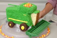 How to make a John Deere combine birthday cake. Love the candy corn!