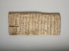 """Writing board, ca. 1981–1802 B.C. Egypt. The Metropolitan Museum of Art, New York. Gift of Edward S. Harkness, 1928 (28.9.4) 
