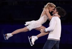 Pairs gold medallists Tatiana Volosozhar and Maxim Trankov of Russia perform in the figure skating closing gala at the Sochi Winter Olympics on Saturday (Paul Chiasson/CP).
