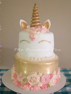 Unicorn Cake - Gold with pink & peach toned flowers. Kelly Dillon @thefondantfox on Facebook.