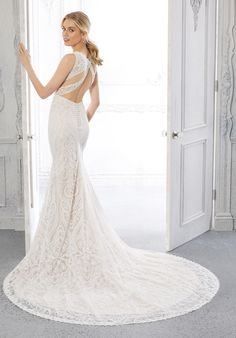 This geometric lace fit and flare bridal dress has a sleeveless, high-neck, illusion bodice and a strappy keyhole back. Wedding Gown Sizes, Bridal Wedding Dresses, Bridesmaid Dresses, W Dresses, Flower Girl Dresses, Formal Dresses, Grey Prom Dress, Mori Lee, Illusion