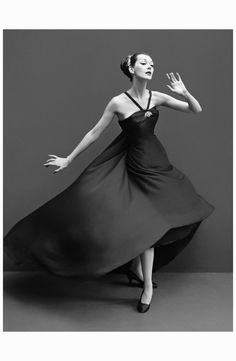 Dovima in a dress by Dior.  Photo Richard Avedon.  October, 1955.