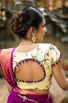 Buy House Of Blouse Light yellow floral U neck blouse with pom pom detailing online in India at best price.Like blackberry coulis on a butterscotch ice-cream, this floral printed blouse blends the two colors Blouse Back Neck Designs, Sari Blouse Designs, Saree Blouse Patterns, Fancy Blouse Designs, Latest Saree Blouse, House Of Blouse, Stylish Blouse Design, Collor, Boutique