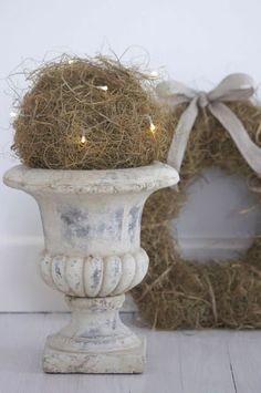 Big decorative urn with Christmas lights in some sort of dry branches. Christmas Makes, Noel Christmas, Rustic Christmas, Winter Christmas, Xmas, Christmas Lights, Garden Urns, Ball Lights, Christmas Decorations