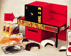 1970's Easy Bake Oven (This is JUST LIKE the one I had!) Nothing like cooking with the heat of a 60 watt light bulb! :)