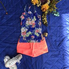 Floral Tank Top Delia's Brand Blue floral tank. Super comfy. Great fit. Like new condition. Inspected for rips, stains and odors. Tops Tank Tops