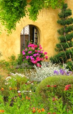 love the warm colors of so many stucco facades... and the gardens!