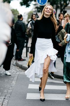 white ruffle skirt, black sweater
