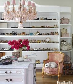 Gorgeous pink chandelier and chair. A vintage armoire was enlarged to use for closet storage. - House Beautiful