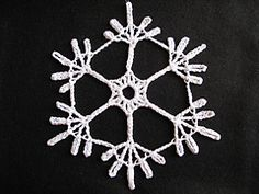 Summary Two snowflakes in three sizes depending on thread and crochet hook. Snowflake B is here.