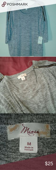"""New With Tags, """"Misia"""" M, grey sweater Regular Ladies size Medium, knit woven, duel thread sweater, half sleeves, zippers on shoulders that actually zip & unzip, pockets 1 on each hip sides, New With Tags, """"Misia"""" name brand, Made in Vietnam, 75% Rayon, 24% polyester, 4% spandex,  hand wash, do not bleach. RN#51390 STYLE#RSM60214 PO#MI1802 Original retail-$34.98 Misia Sweaters Crew & Scoop Necks"""