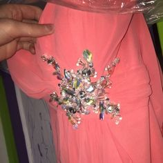 Coral Prom dress Floor length coral prom dress. Worn once. Sweetheart neckline. Has a leg slit on the left side where the Ruffles are:) all jewels are in perfect condition. No stains or tears. SIZE SMALL. Willing to negotiate price :)! Sherri Hill Dresses