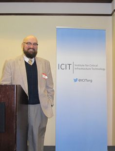 New Fellow Chris Schumacher (Sr. Technology Consultant, New Light Technologies) is welcomed by his peers to ICIT