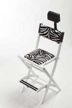 SET BLACK WOODEN MAKE UP CHAIR S104 + HEADREST. Makeup director chairs. Cantoni for makeup and aesthetic professionals. Here in white and animalier version, this make-up chair has an exclusive design. This one doesn't overturn when your customer sits up and down, the chair in easily foldable and it can be customized. #makeupideas #exclusivedesign #headrest