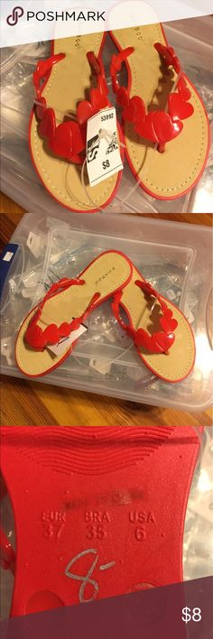 Cute Red Flipflops Red flip flops. Red upper rubber design in heart pattern. Never worn Bamboo Shoes Sandals