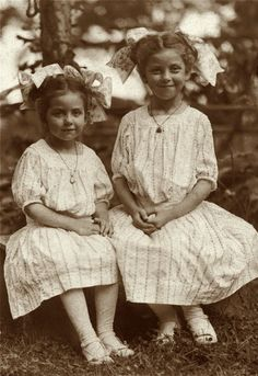 SUNDAY DRESSES: 1913. Two little sisters pose on their Sunday Best.