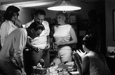 Frank Sinatra, Peter Lawford, Patricia Lawford (Kennedy) and Marilyn Monroe at the Lawford's home in Santa Monica, California, 1961.