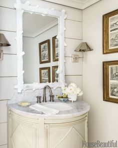 The designer's mirror and wall art choices fit his eccentric taste.