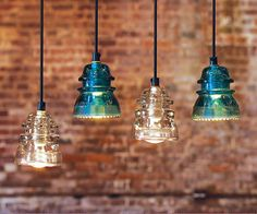 These pendants are made from re-purposed original glass insulators, some of which are more than 100 years old.