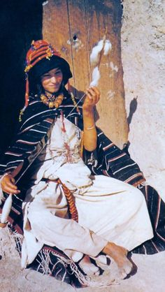 Africa: Colored old photo of Berber girl spinning wool, middle Atlas, Morocco