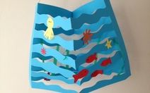 Paper Ocean.    Gold fish snack and precut shapes can also be used for this