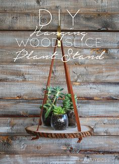 This is such a clever idea for a plant stand. Take a wood slice or wood round and use leather ties (like an old belt or strips from an outworn jacket) to hang from the wall or ceiling.