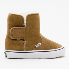 Vans Slip On Boot, bruin winter 2012, the website is in another language....does anyone know if available in US.? I'm on the hunt...these are darling...Uggs for lil skater dudes! LOVE IT! There's a pic on website of them on a kid....ADORABLE! IF ANYONE KNOWS WHERE TO GET THEM AND THE PRICE IN U.S. $$ LEMME KNOW!!
