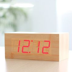 HITO™ Digital Clap-on Fashion Wood Grain Red LED Desktop Alarm Clock - Time Calendar Thermometer function - Sound Control - Latest GEN Display: This clock can be set to only display time. OR clock displays time, date & temperature in turn automatically (Default);. Sound control function: when sound control function is on, the LED display turns off after about every 15 seconds, and then you clap ... #CE