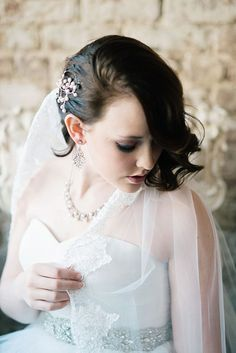 Dark smokey winter bridal makeup with pearls hairpiece
