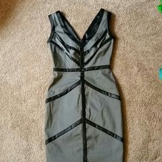 Sleeveless Gray Dress Beautiful, classy XOXO dress. Fits like a glove at a size 1 / 2. Deep V cut neckline. Can be work to work or out in the town. Hidden zipper in the back. Worn once. XOXO Dresses