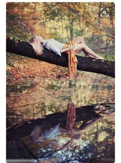 I like few pose in this picture laying on the branch an I like the way the picture captures her reflection in the water
