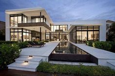 Awesome house design. Lots of windows with black liner. #modern