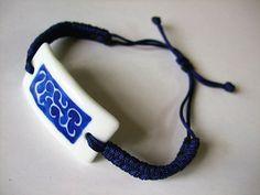 Ceramic jewelry, handbraided dark blue wristband, rolled grass pattern china piece, broken china jewelry. $10.99, via Etsy.