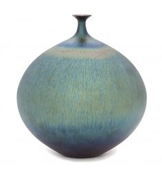 An Iridescent Pottery Weed Vase, Hideaki Miyamura,of bottle form, the globular body having a blue and green glaze.Height 9 inches