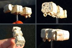 """Mobquet Medium Transport (2009) (from """"Star Wars: Dark Empire"""" comic series) - by David Canavese of Otherlife Art. Made entirely of paper and white glue, except for the removable acrylic stand. About 1.25 inches long. #starwars #mobquet #darkempire #papercraft #papermodel #otherlife #tiny #teeny #ittybitty #micro #spaceship"""