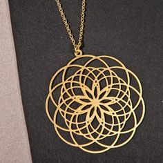 Flower of Life Necklace \ Seed of Life Necklace Large Mandala Pendant \ Sacred Geometry Necklace \ Torus Spiritual Necklace \ Yoga Jewelry    This is a magical necklace 100% hand made 100% heart and a completely unique design,   made by Inspirala Boutique.  Inspired from the sacred geometry patterns in nature, this pendant offers the wearer a sense of peacefulness and rightness. The necklace, it's simple design, a spiritual piece of jewelry that you will love and cherish.    • The Pendant…