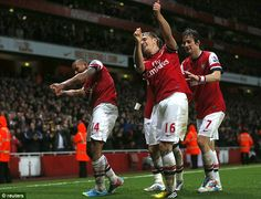Four-some: Walcott and Aaron Ramsey lead the celebrations after the Welshmans strike at the Emirates