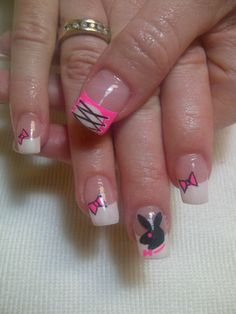 Playboy bunny nails - hot pink, bows, and a corset over a French manicure.