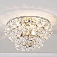One Common Decorating Mistake | by Interior Designer, Laurel Bern;Bling semi-flush mount. These look great in bathrooms or halls. Very stylish and they give off a gorgeous light!