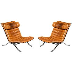 ARNE NORELL pair of vintage leather and steel lounge chairs