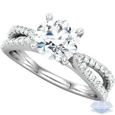 1.38 ctw ROUND VS1 Diamond Solitaire Engagement Ring 14K WHITE GOLD 1 1/2 Carat - Elegant and bold this split shank style diamond ring with Pave accents in 14K white gold features a 100% natural, earth-mined Round Brilliant cut center diamond weighing 1 carat. This diamond is graded I color, VS1 clarity enhanced and is cut to VERY GOOD proportions. Complemented by 46 Round Brilliant diamonds set into the shank adding an additional 3/8 carats to the total weight of this beautiful ring. BIG…