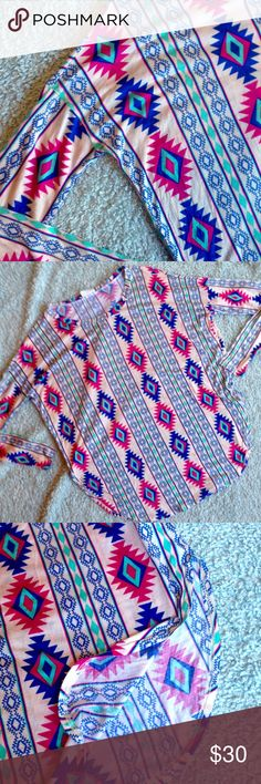 Split Sides Aztec Tunic Aztec/tribal/geometric tunic top. Beautiful colors that make the design pop! Thin, soft, jersey-knit material. Loose fitting (could fit a M), dolman style 3/4 sleeves. Side slits. Goes great with leggings or skinny jeans. Very comfortable! Boutique brand Fantastic Fawn. Fantastic Fawn Tops Tunics