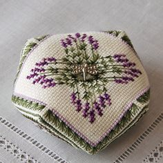 This biscornu was an honorable mention in the Needlearts Pincushion contest. It is a pair with Lavender Fields, also available in my shop.