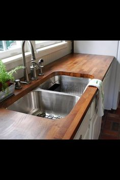 Kitchen idea. LOVE the wood counter tops! They could double as a cutting board..